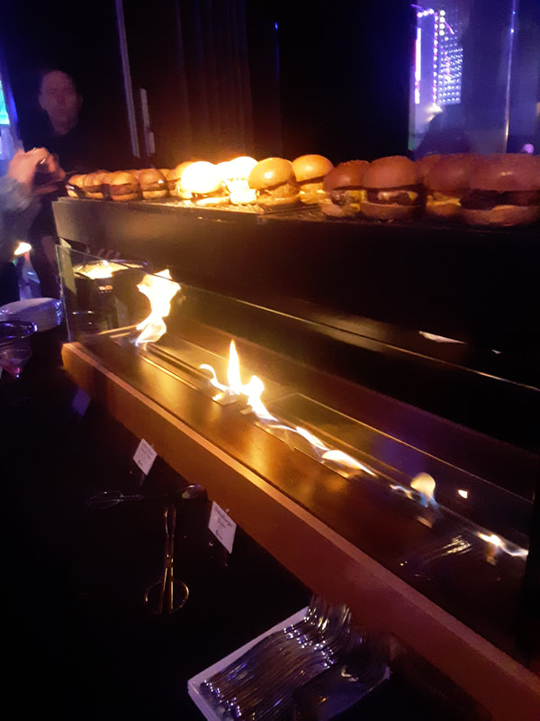 Flaming catering display at Manhattan venue.