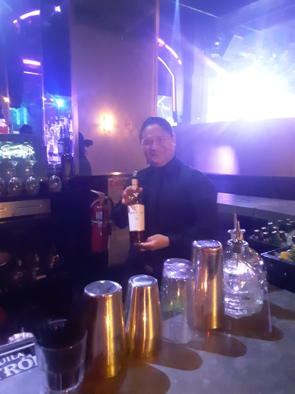 Smiling bartender at Chelsea NYC event space.