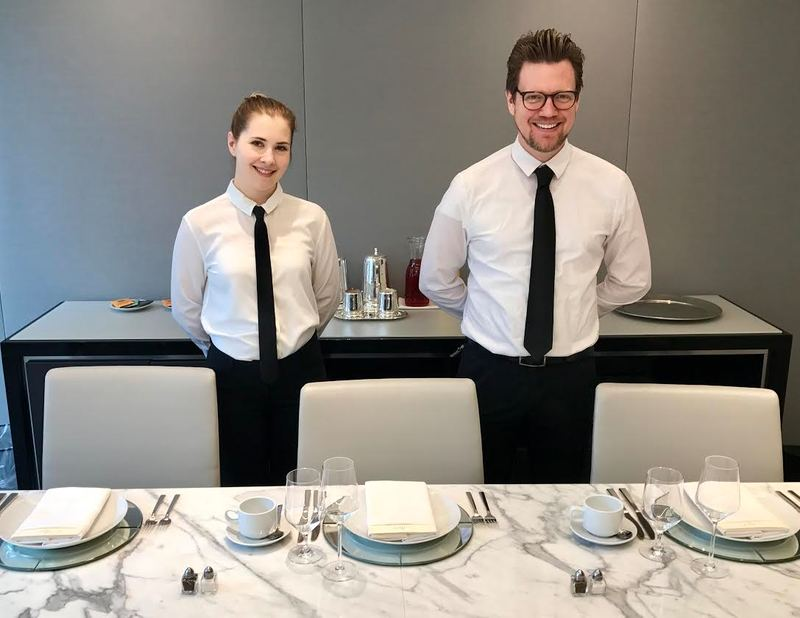 Smiling catering waitstaff.