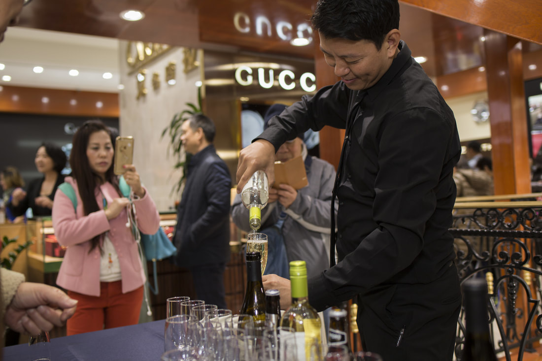 Bartender preparing drinks at catered NYC event.