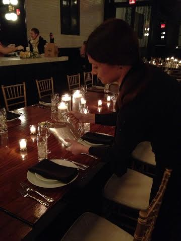Server setting table for catered Brooklyn NYC event.