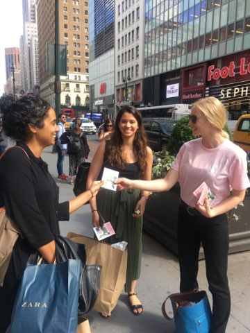 Tapuz Staffing passing out promotional materials in Manhattan