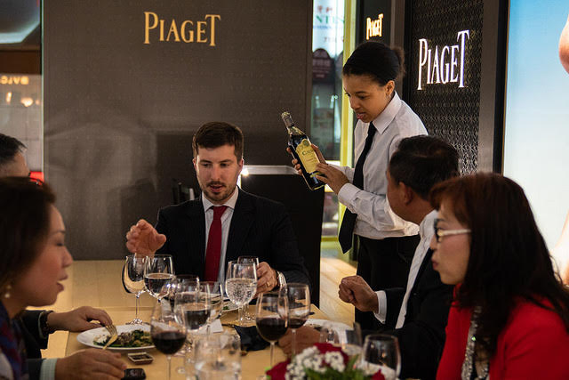 Waitstaff serving wine at catered NYC event.